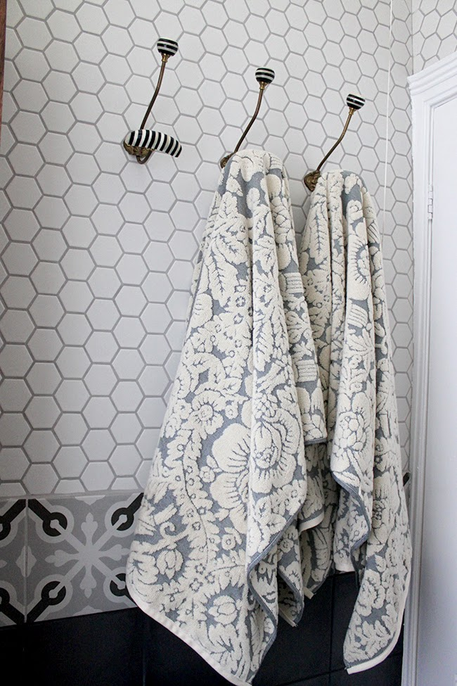 Hex tiles which we chose for our eclectic boho glam bathroom remodel
