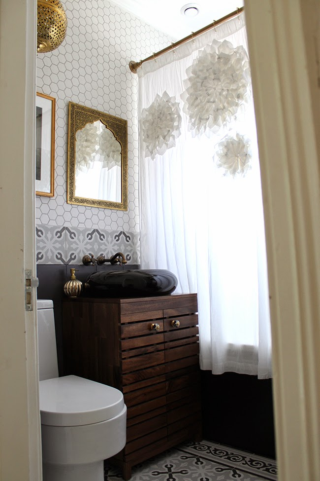 We FINALLY finished our bathroom remodel, take a look at the finished eclectic boho glam look.