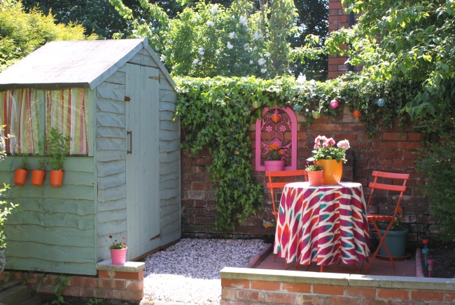 small shed and colourful patio