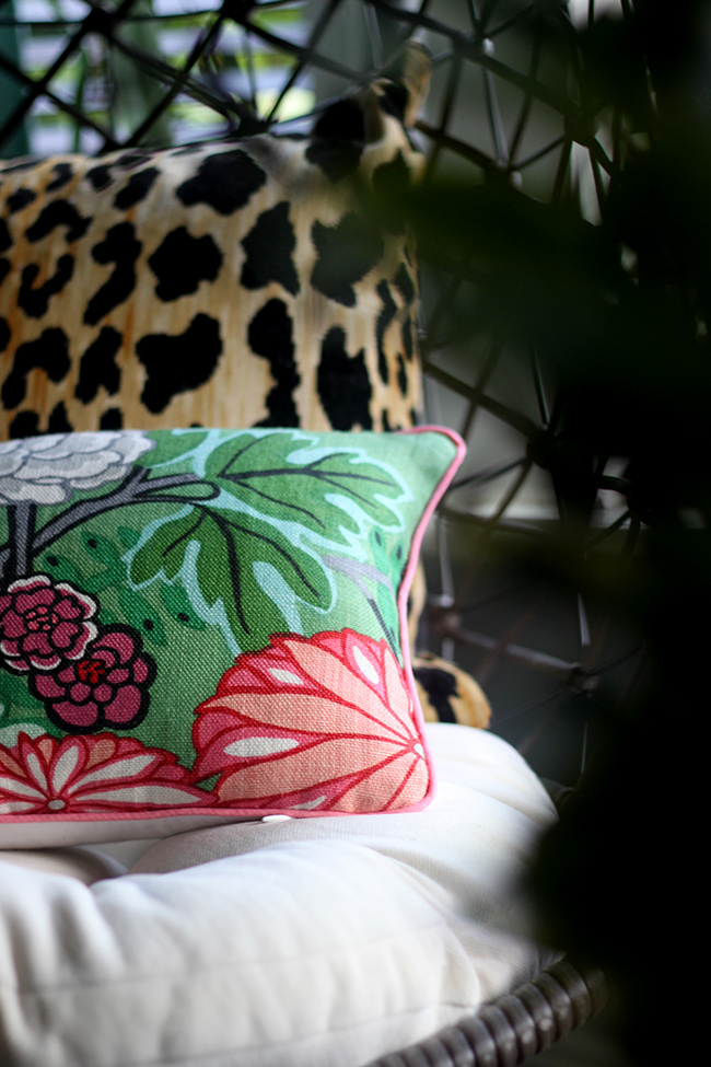 leopard print cushion and chaing mai dragon jade cushion on hanging chair from Out There Interiors