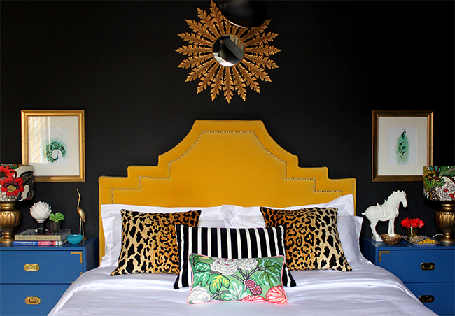 black bedroom with yellow headboard