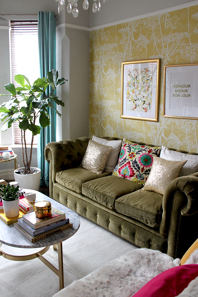 living room with olive chesterfield and gold accessories