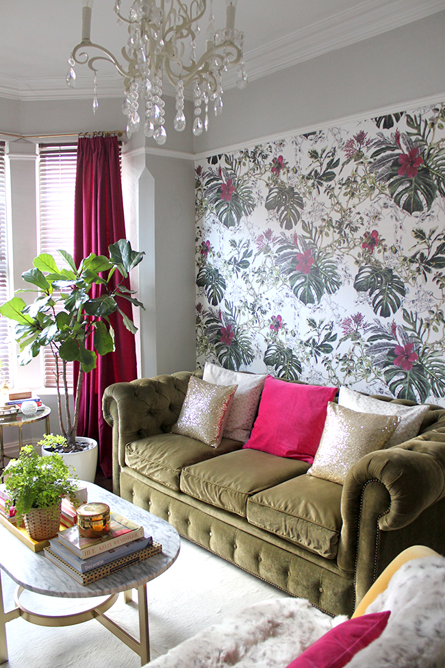 Swoon Worthy living room with Sian Zeng Summer Tropical Blossom wallpaper in olive and berry pink