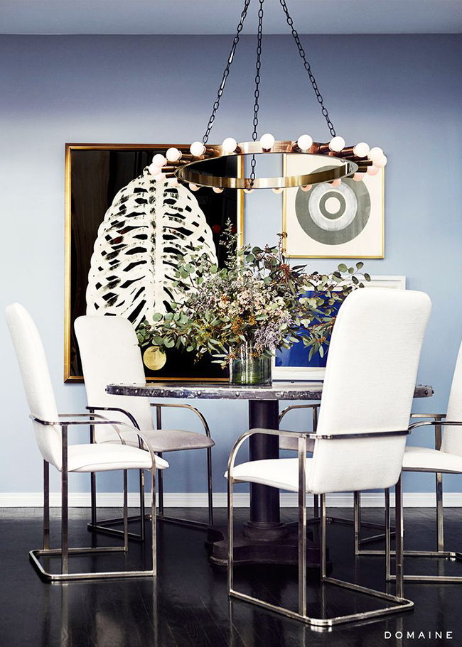 blue dining room with large art