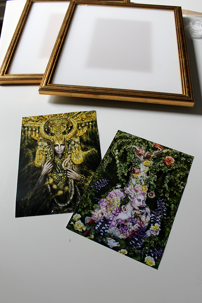 I added some of Kirsty Mitchell's work to my home by framing postcards as art