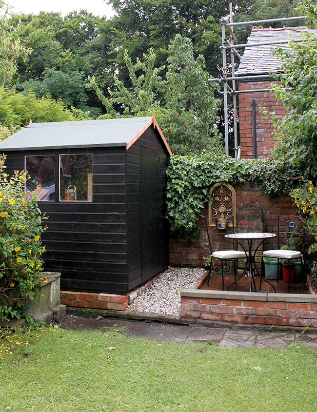 Swoon Worthy - Black Shed and brick patio