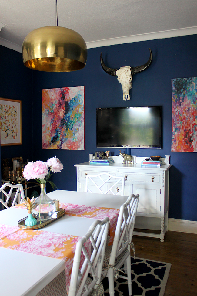 Swoon Worthy dining room in navy blue, pink and orange