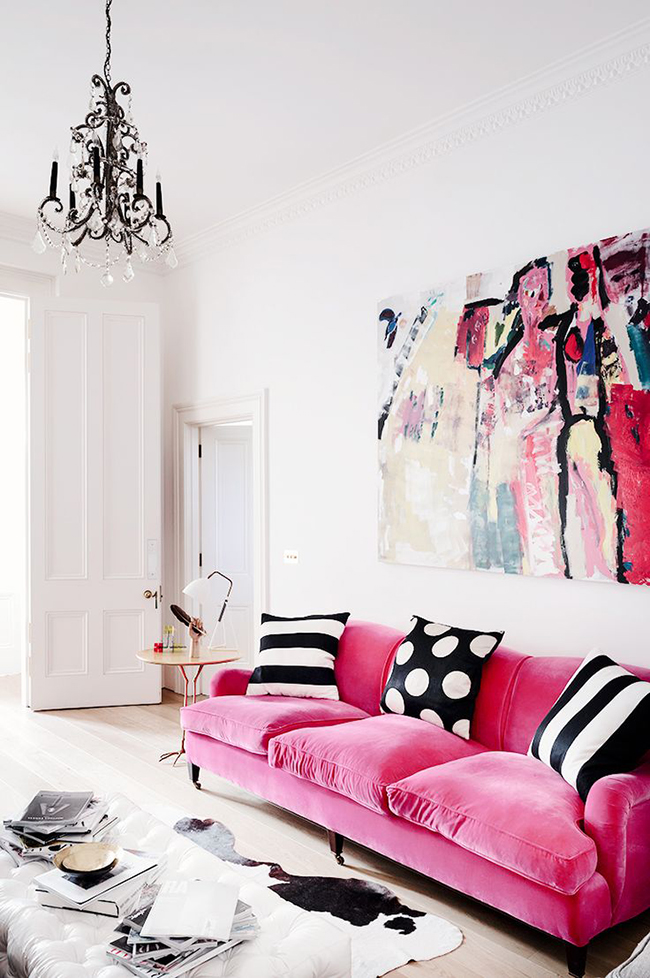 pink sofa and artwork