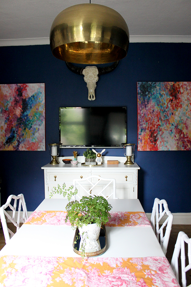 Swoon Worthy - dark blue dining room with white table and brass light