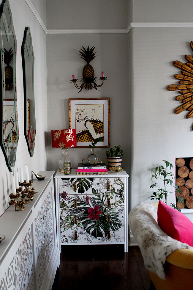 Swoon Worthy Living Room - wallpapered chest of drawers with pineapple sconce
