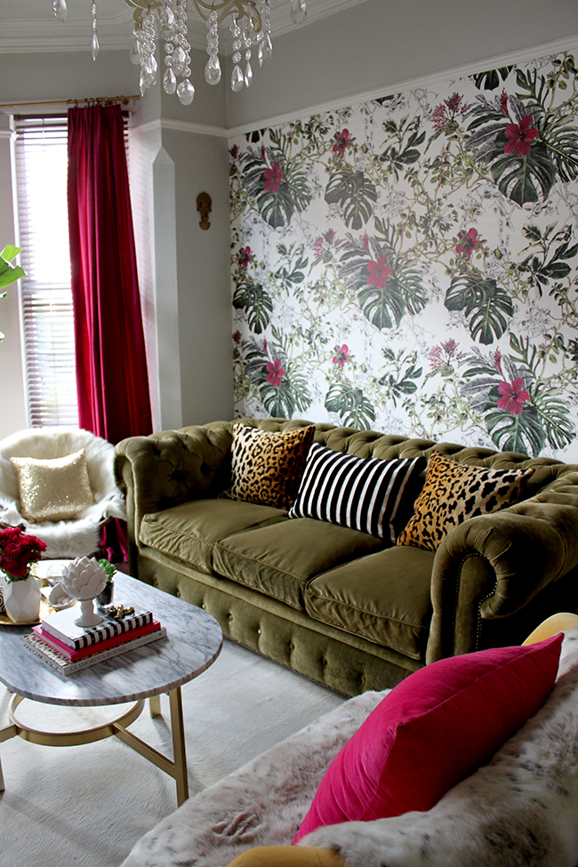 Swoon Worthy Living Room - tropical wallpaper, olive green velvet chesterfield with leopard cushions and marble coffee table