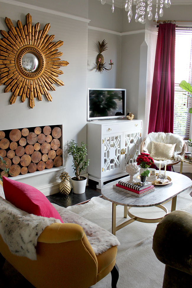 Swoon Worthy living room - vintage white TV cabinet, marble coffee table, gold starburst mirror