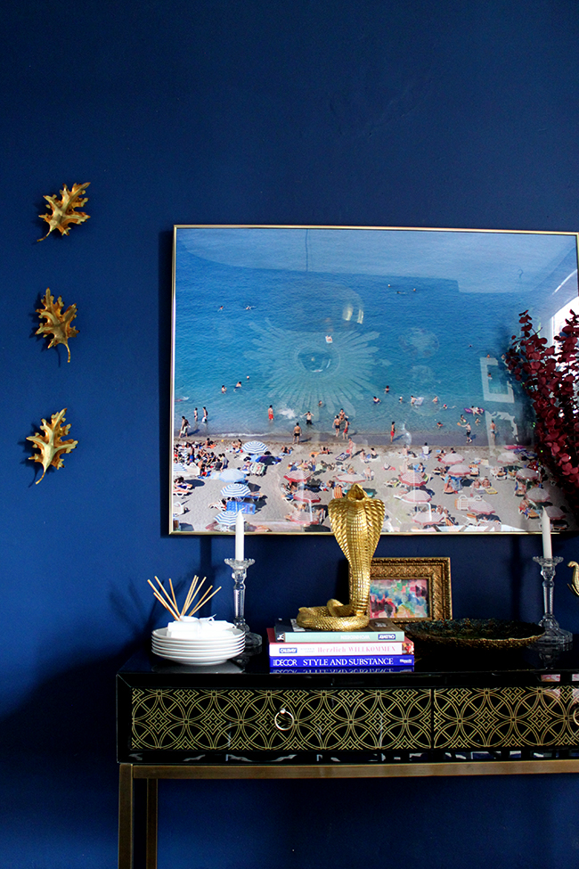 Swoon Worthy dining room - console table with beach photography art, gold cobra vignette