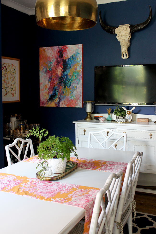 Swoon Worthy dining room - dark blue with colourful abstract art