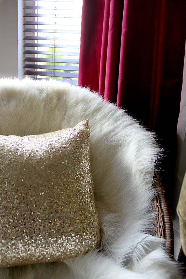Swoon Worthy living room - goat hair throw on hoop chair