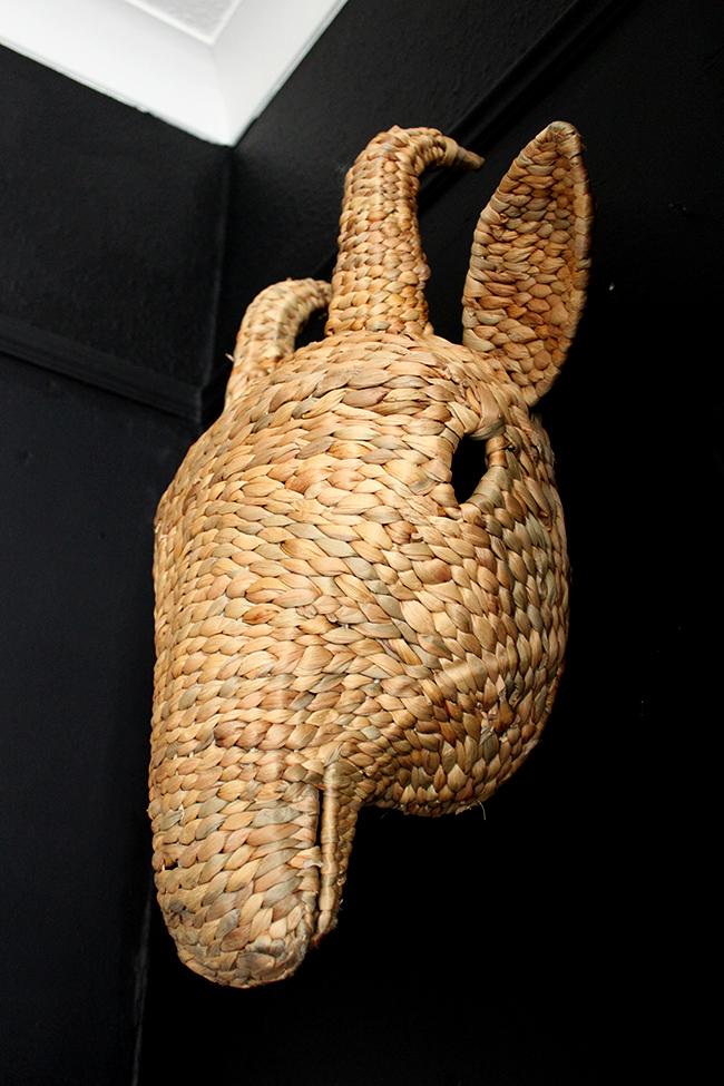 Swoon Worthy bedroom - woven animal head on black wall