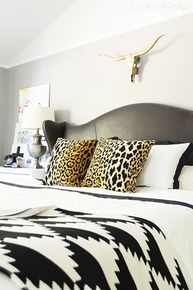 Cuckoo4Design neutral bedroom with leopard print cushions