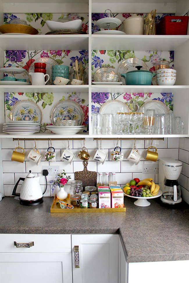 Swoon Worthy kitchen - floral wallpaper backed shelving, gold accents, leopard print cutting board
