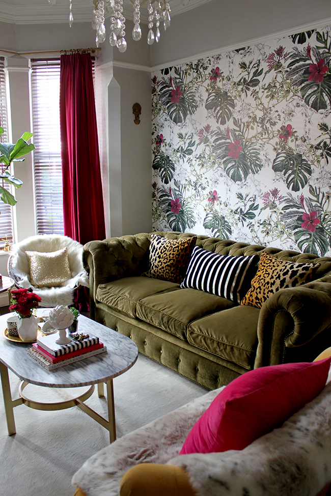 Swoon Worthy - leopard print cushions on olive chesterfield with tropical wallpaper