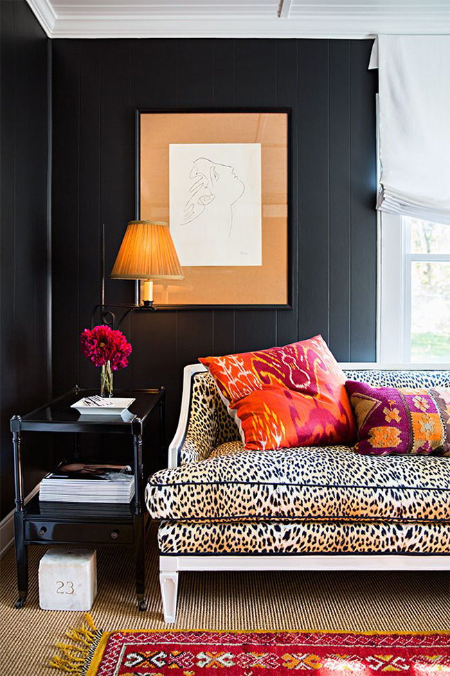 black living room with leopard print sofa