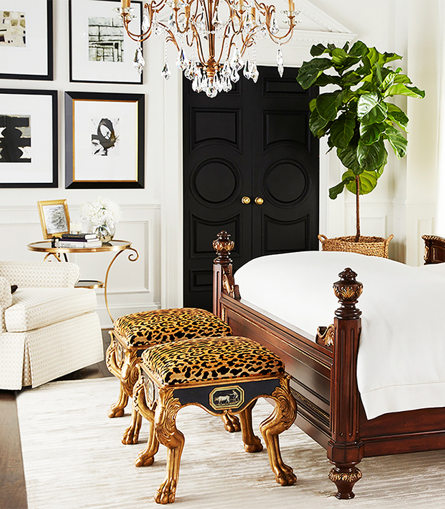 leopard print stools at foot of bed