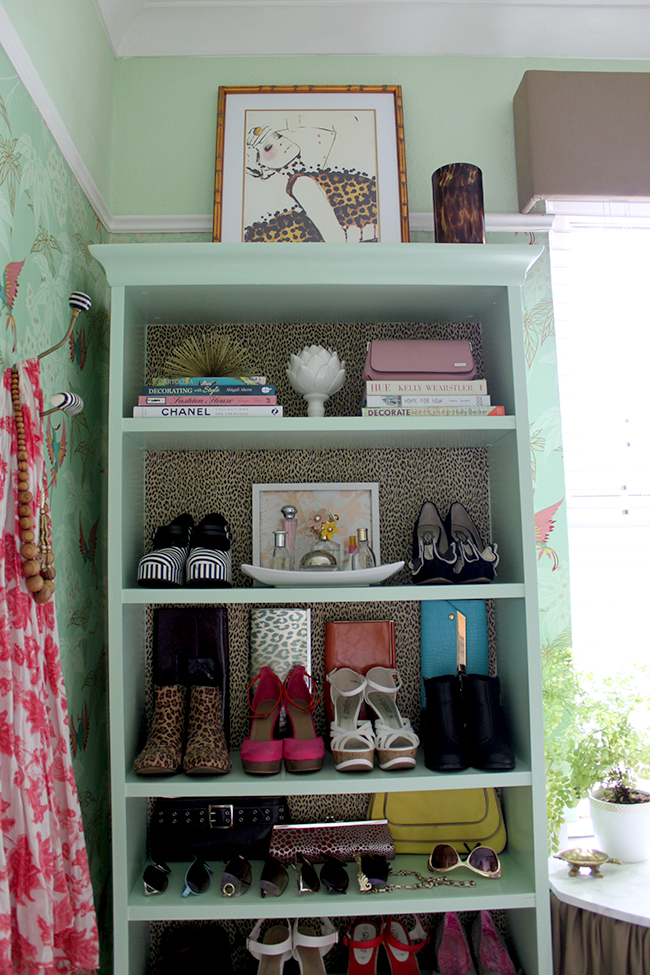 Billy bookcase hack with leopard print wallpaper backs