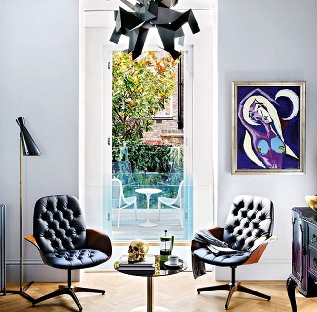 eclectic sitting room in black and lilac