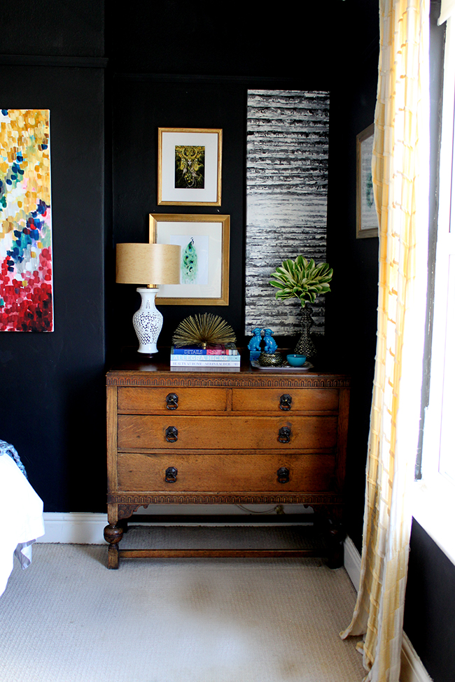 Swoon Worthy bedroom - vintage dresser with black walls and bright accents - www.swoonworthy.co.uk