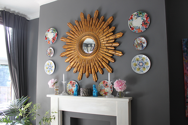 Swoon Worthy dining room in grey with gold starburst mirror