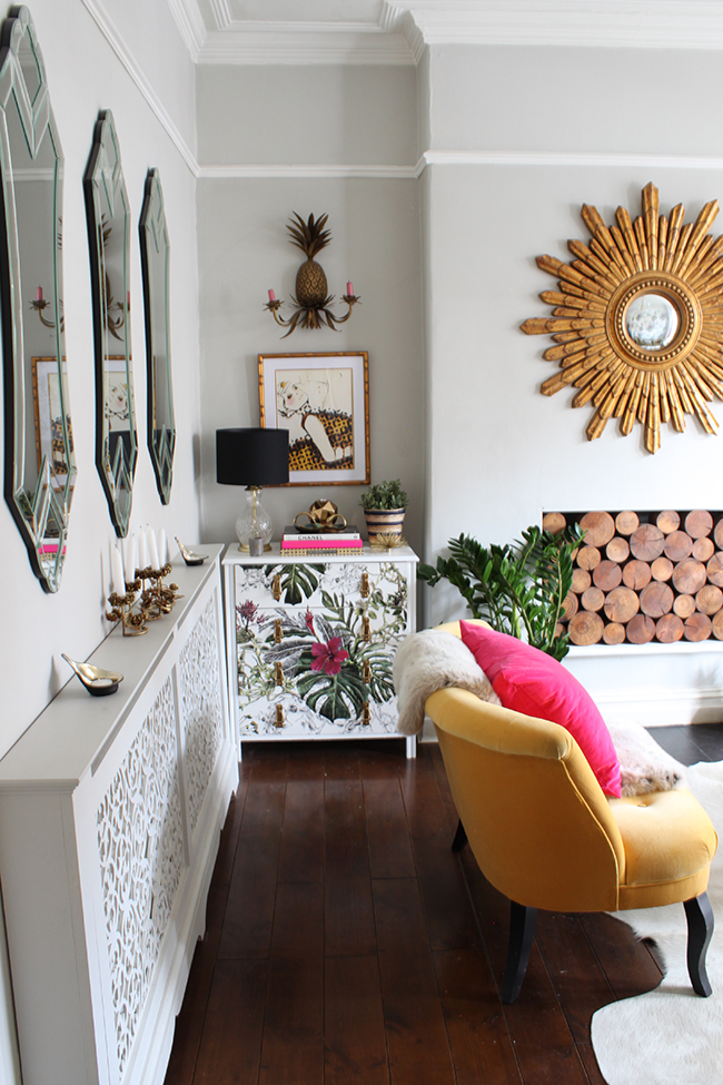 Swoon Worthy - pale grey living room with gold starburst and yellow sofa