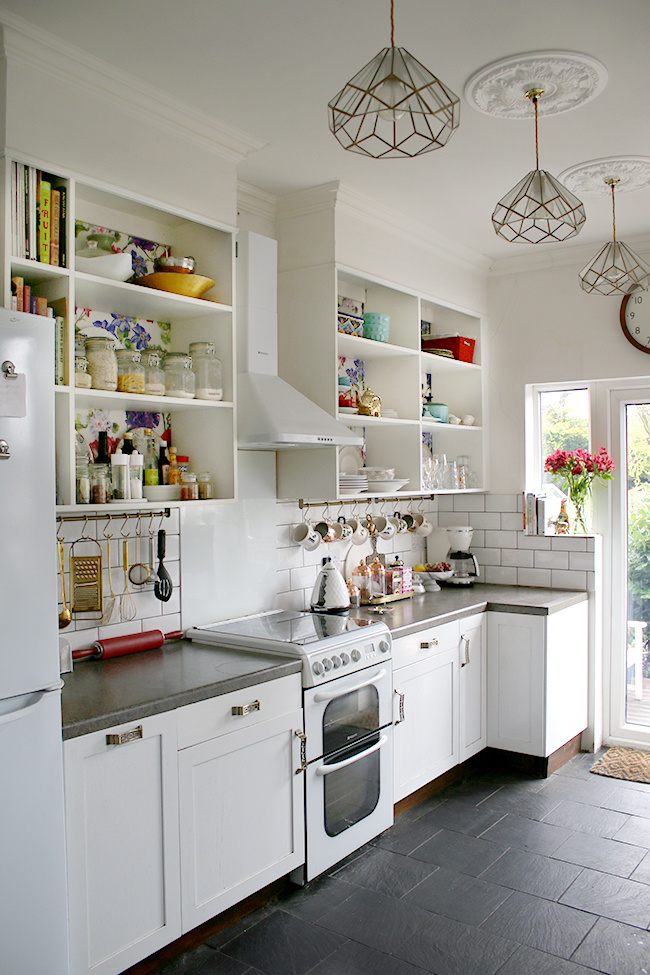 white kitchen with subway tile and colourful accents - see more at www.swoonworthy.co.uk