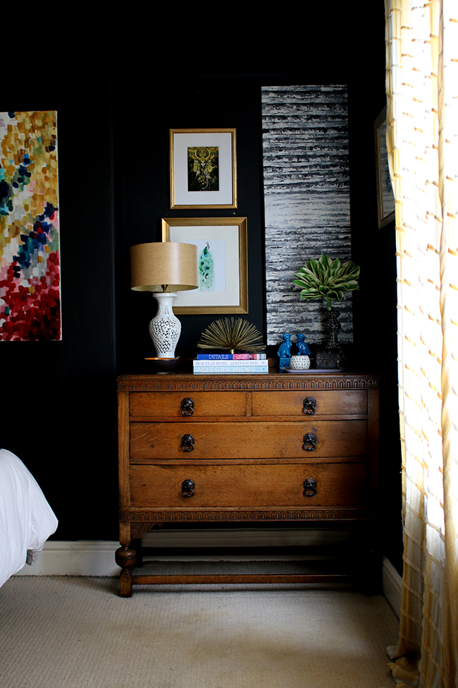 black bedroom with colourful accents and vintage chest of drawers - see more on www.swoonworthy.co.uk