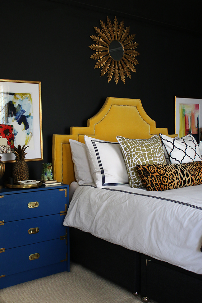 Swoon Worthy black bedroom with yellow headboard ikea rast hack colourful artwork leopard bolster