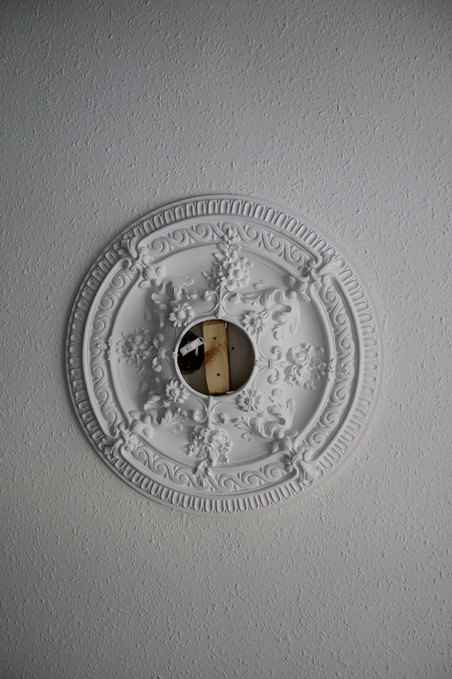 ornate ceiling rose with missing light
