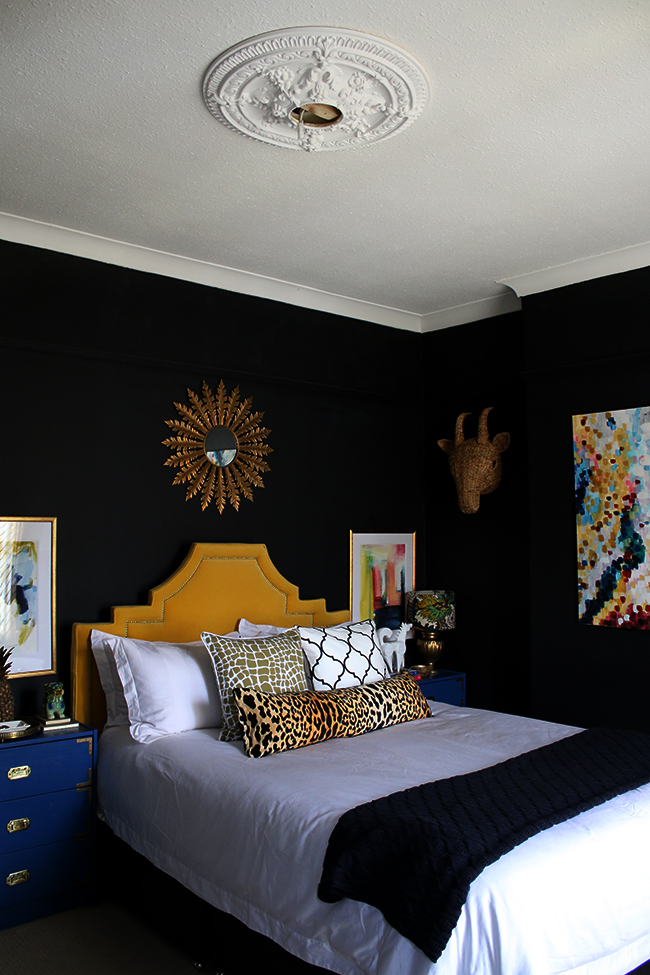 black bedroom with bold accents