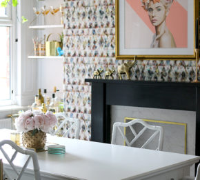Eclectic glam living room with graphic feature wallpaper, leopard print chairs, black and marble fireplace, gold light fixture - see more on www.swoonworthy.co.uk