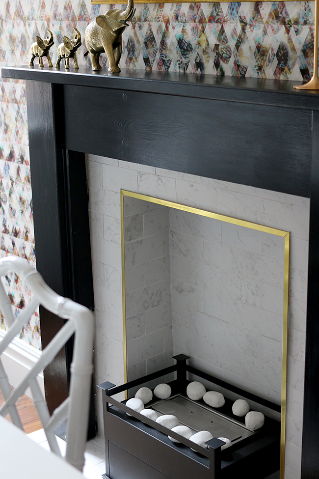 black fireplace with white marble and gold trim - see more on www.swoonworthy.co.uk