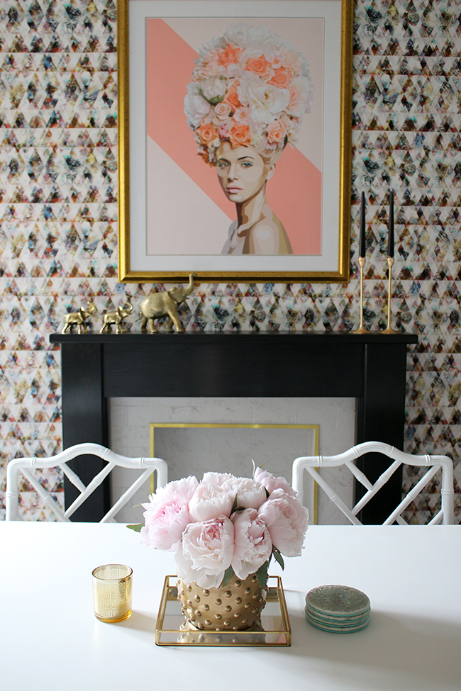 graphic feature wallpaper on chimney breast, black and white marble fireplace with gold trim, peonies - see more on www.swoonworthy.co.uk