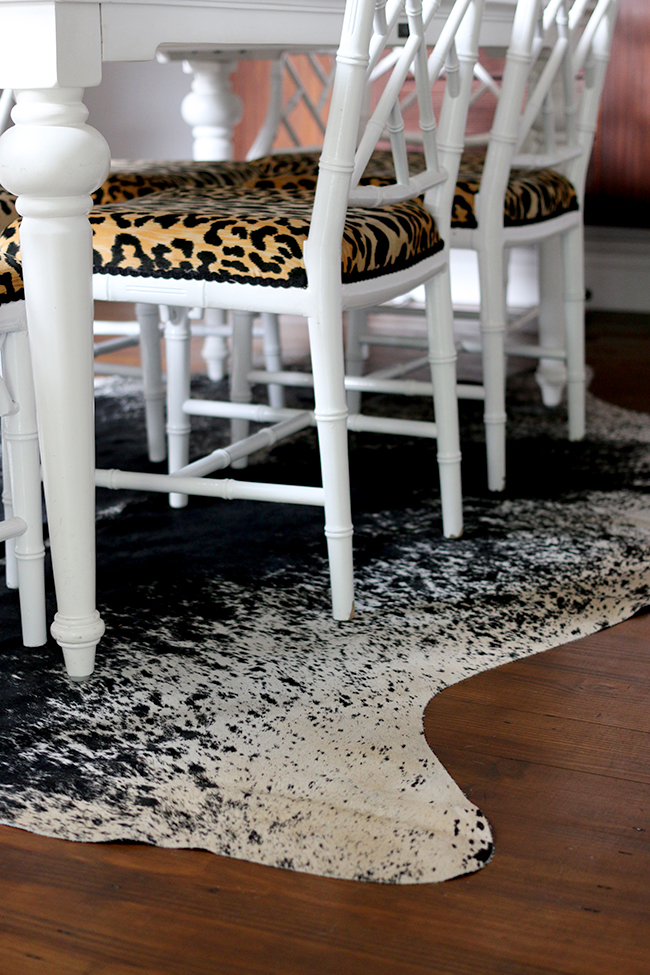 faux bamboo chinese chippendale chairs on black and white cowhide rug - see more on www.swoonworthy.co.uk
