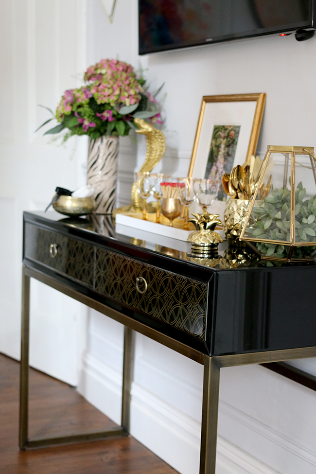 console table vignette with lots of gold - see more on www.swoonworthy.co.uk