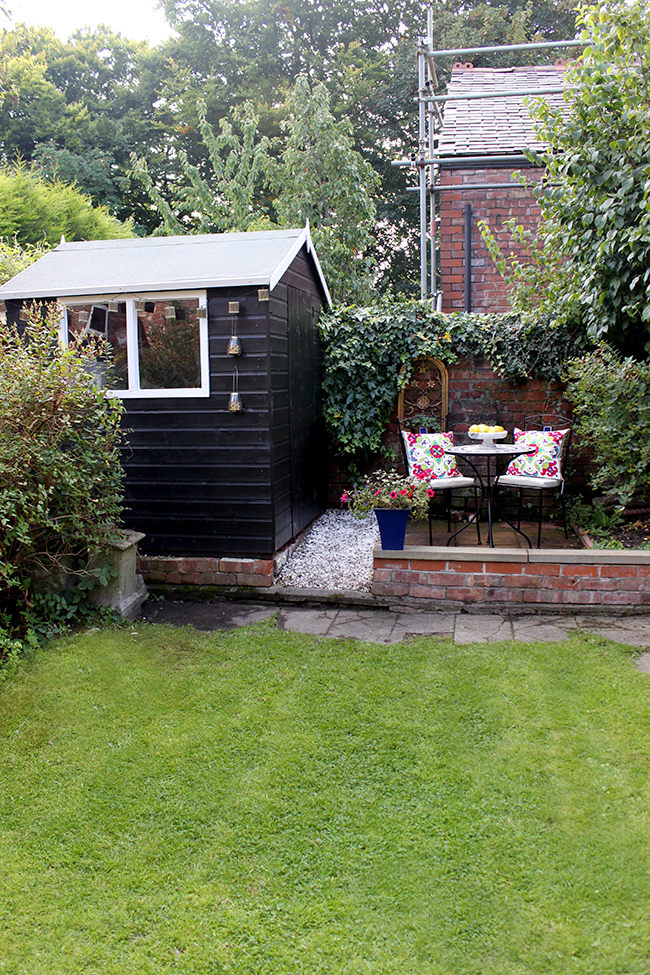 End of garden patio and shed