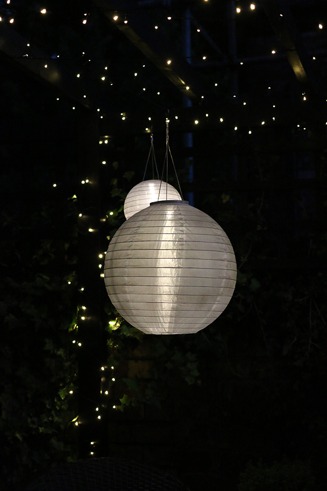 patio with fairy lights and solar chinese lanterns