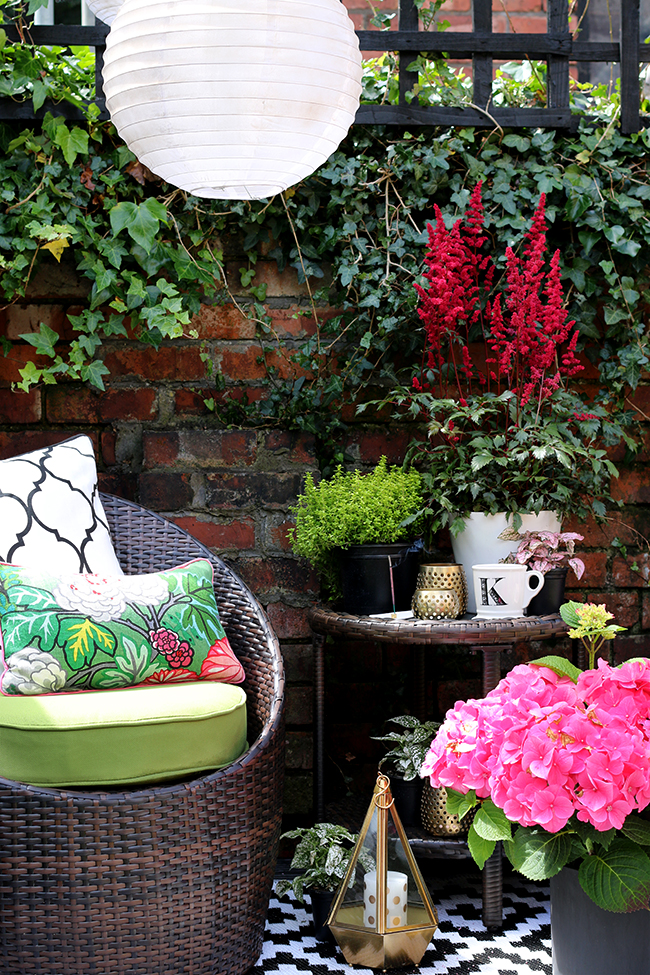 Patio with brick wall with solar chinese lanterns