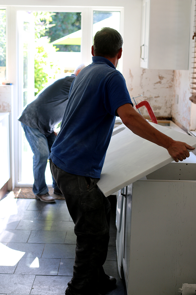 Setting the worktops into place... VERY carefully.