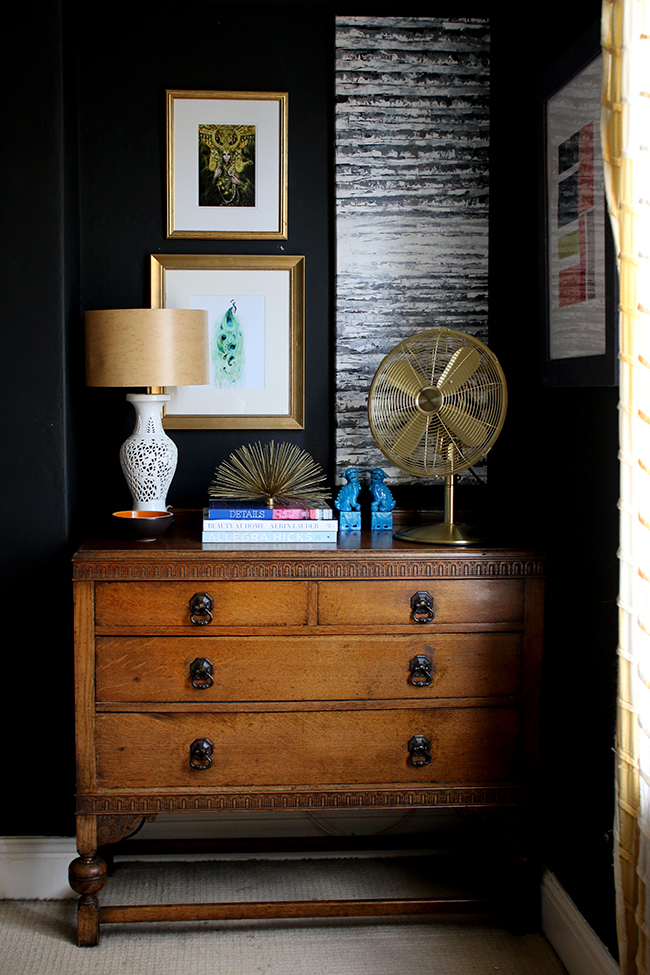 Swoon Worthy - black walls with gallery wall and vintage dresser with gold table fan