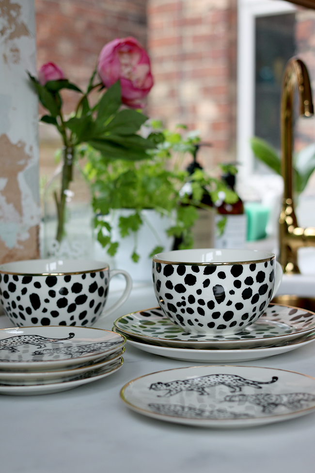 black and white leopard print mugs and plates with gold trim from H&M Home