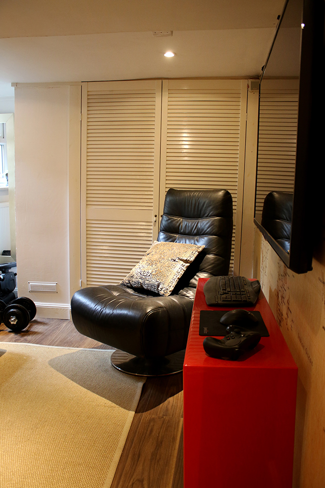 The man cave with large black gaming chair
