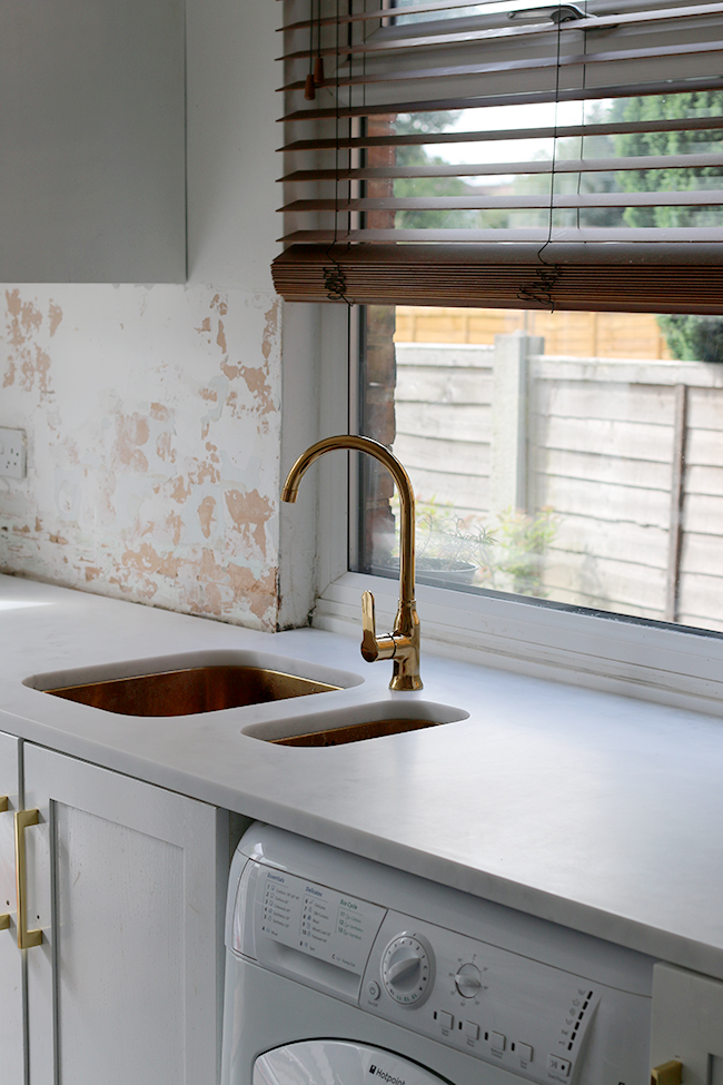 minerva carrara acrylic worktop join around windowsill