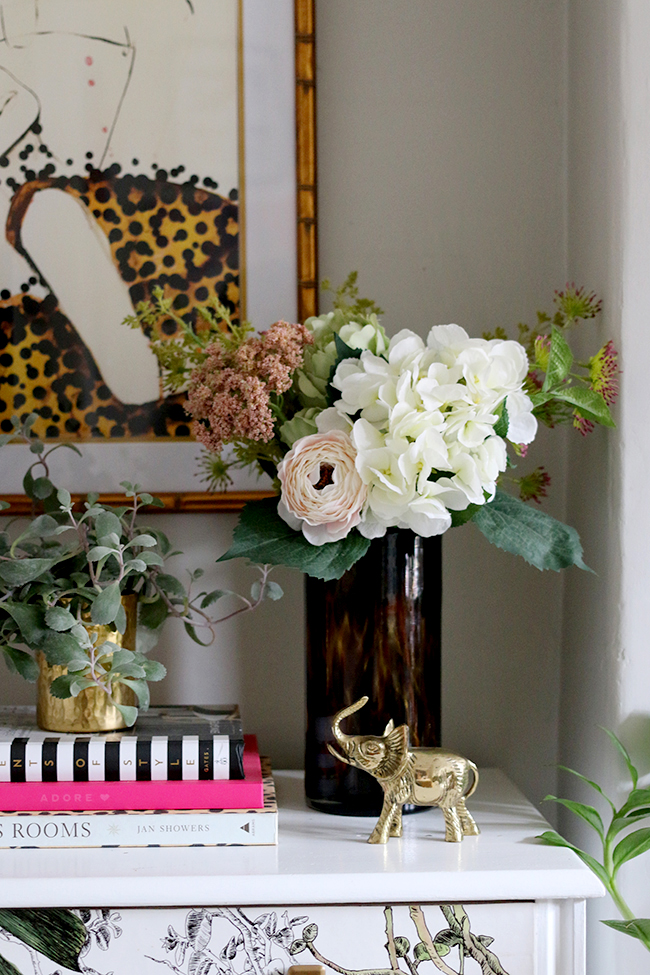 living room vignette with plants and flowers