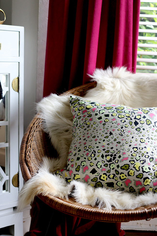 Simple updates that cost very little - leopard print cushion with goats hair throw on rattan chair